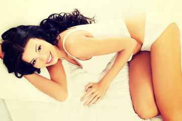 Beautiful woman lying on bed.