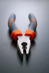 Combination Pliers Hand Tool on a Gray Background