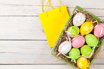 Easter background with colorful eggs and gift bag