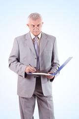 Successful Senior Businessman Signing Documents