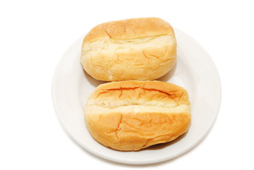Two Dinner Rolls on a White Plate