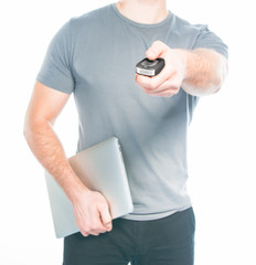 Man with a remote control from the car in the hands