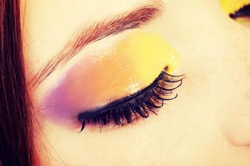 Beautiful woman with artistic eye make up.