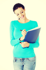 Student woman with note pad and pen.