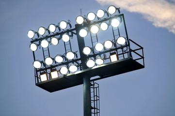 Stadium lights at sunset