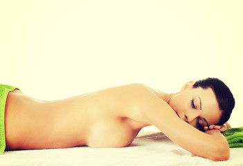 Beautiful woman lying on a massage table.