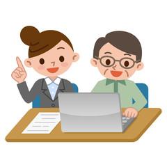 パソコンを使うシニアと教える先生