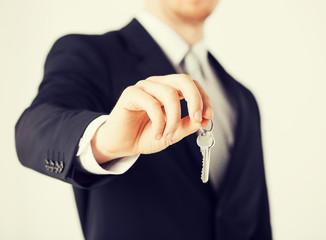 man holding house keys
