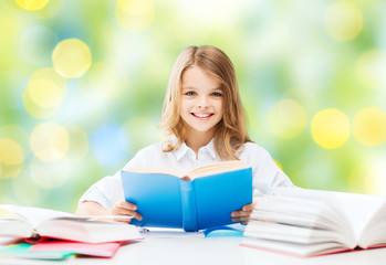 happy student girl reading book at school