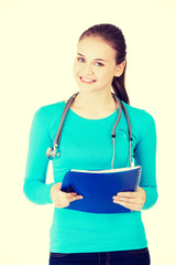 Happy medicine student with note pad.