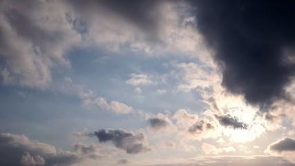 Dramatic dark clouds at sunset. Timelapse.