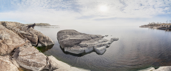 Rocky shore of the lake on a sunny day.