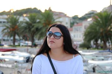 Dark Hair Woman iwith Sunglassess