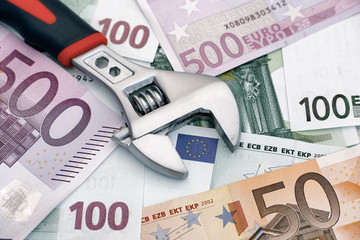 Adjustable wrench on euro banknotes