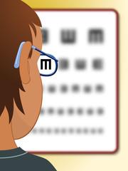 Niño con gafas leyendo una tabla optométrica
