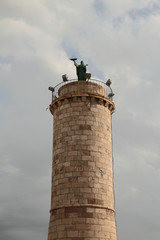 Column with Saint Fermina statue. Civitavecchia, Italy