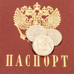 Russian rubles coins against the background of the Russian passp