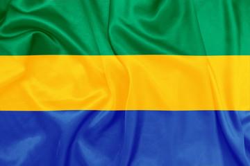 Gabon - Waving national flag on silk texture