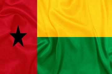 Guinea Bissau - Waving national flag on silk texture