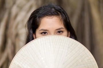 Mysterious Woman Covering Half Face with Fan
