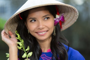 Pretty Vietnamese woman with a flower in her hair