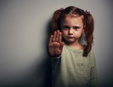 Angry kid girl showing hand signaling to stop useful violence - 79358520