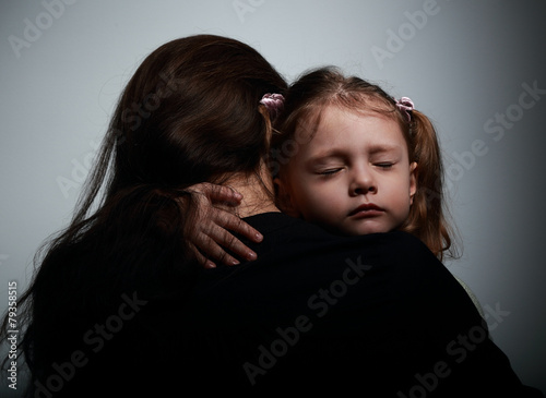 Sad crying daughter hugging her mother with sad face - 79358515