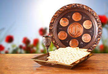 passover background. wine and matzoh (jewish passover bread) on