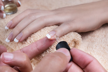 Manicure. Applying the oil