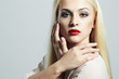 Young Blond woman with manicure.Beautiful model with make-up