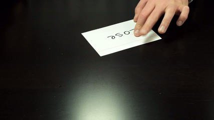 Man hands write the word Lose