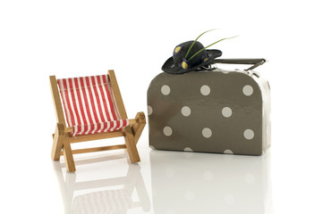 summer suitcase hat and chair