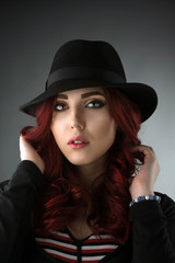 Portrait of a beautiful woman wearing a hat