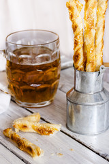 cheese crackers made of puff pastry with sesame seeds