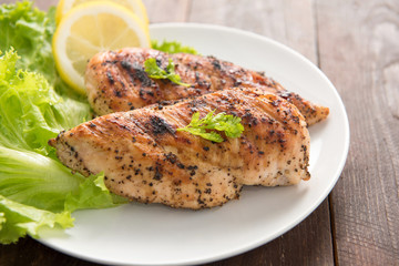 Marinated grilled chicken breasts cooked BBQ and served with fre
