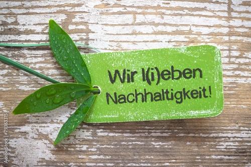 """Leinwandbild Motiv """"Wir leben & lieben Nachhaltigkeit!"""" - grüne Plakette"""