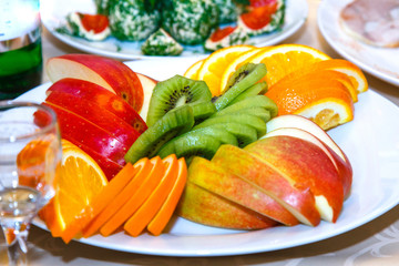 Sliced apples, oranges on a banquet table