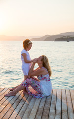 Mother and little daughter on the pier