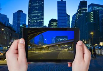 tourist taking photo of New York City in night