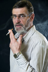 Middle aged bearded man smoking a cigarette