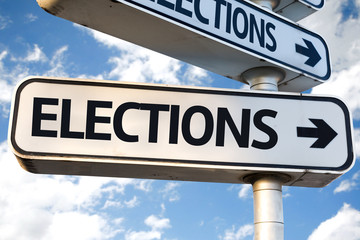 Elections direction sign on sky background