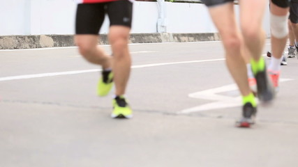 Marathon runners legs on the street