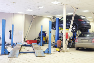 Image of a car repair garage with lift