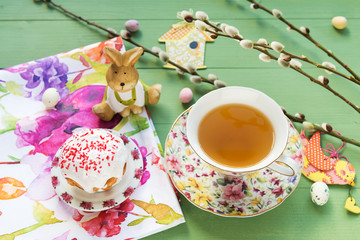 Easter cake, tea and candy with the pussy willow branches