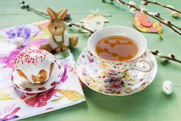 Easter cake, tea, candy with the pussy willow branches