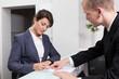 Leinwandbild Motiv Businesswoman signing document