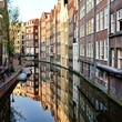 Canal houses of Amsterdam at dusk with reflections, Netherlands