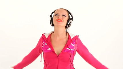 Happy Young Woman Dancing And Listening to Music With Earphones
