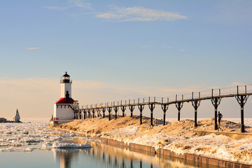 Lighthouse on Sunny Winter Day with Man Running