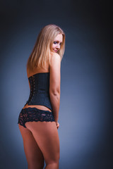 woman in lingerie, back, ass  on a gray  background